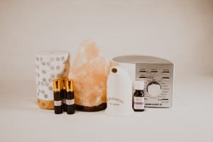 products for better sleep a noise machine a himilayan salt lamp and essential oils