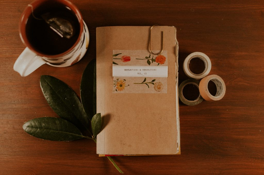 a photo of a journal and tea and journaling supplies